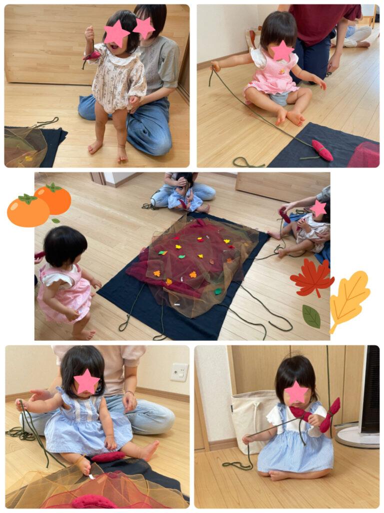 芋掘りリトミックを行う赤ちゃんとお母さん達
